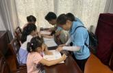 巢湖学院儿童心理教育实践团赴岗岭社区开展课业辅导活动